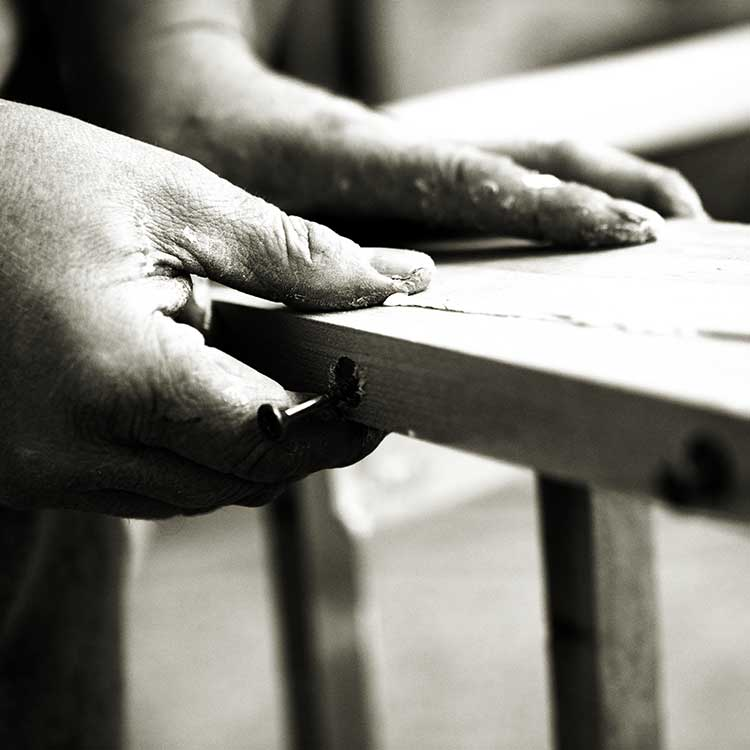 Craftsman making a wooden frame for a luxury sofa