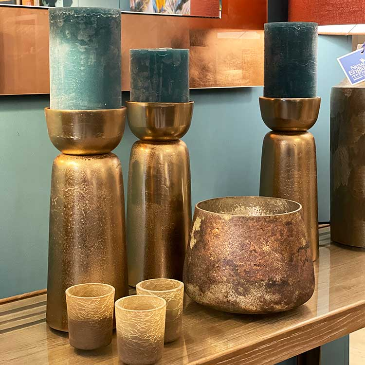Luxury green cylinder candles in aged bronze tall holders