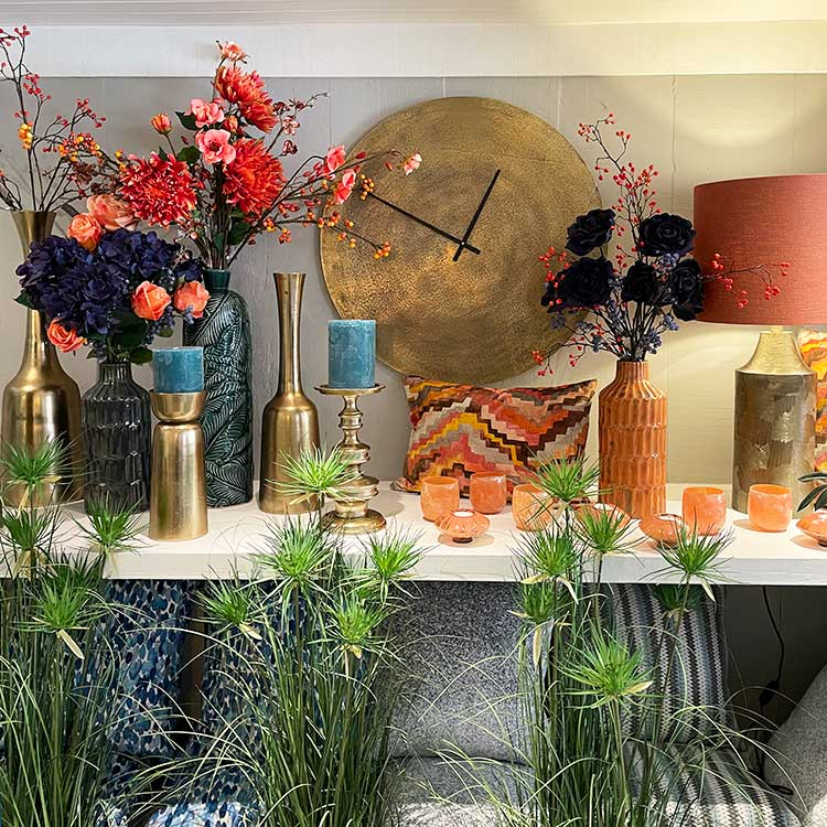 Display of tea lights, vases and candles at New England Home Interiors